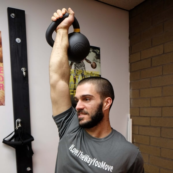 Davide Rief Lifting a kettle bell